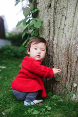 Baby by tree