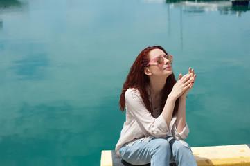 Woman enjoying sunny day at the seaside