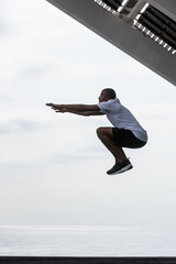 Man jumping above ground