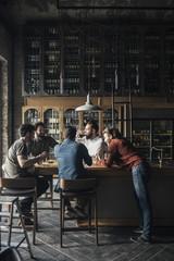 Men Drinking Beer at Pub