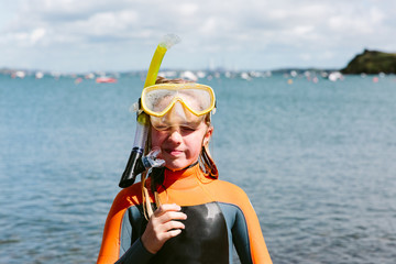 Preteen girl in a snorkel and mask