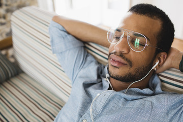 Man listening to the music on the sofa