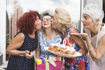 Happy senior women together during a birthday party