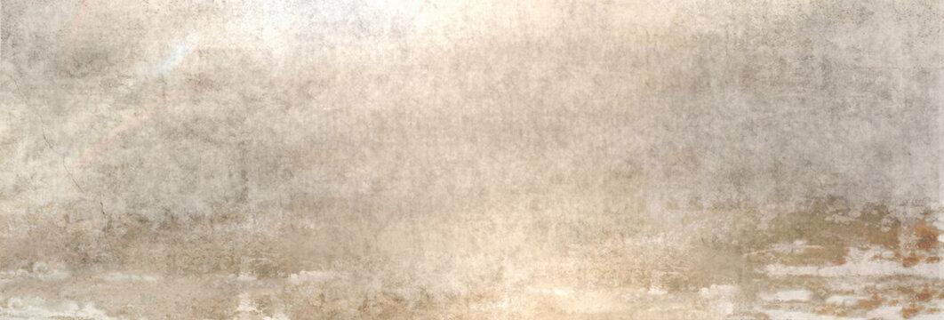 Textur einer alten Betonwand als Hintergrund, auf die etwas Sonnenlicht fällt