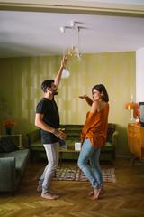 Couple Having Fun Dancing in the Apartment