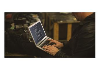 Mechanic Using Laptop Mockup 1