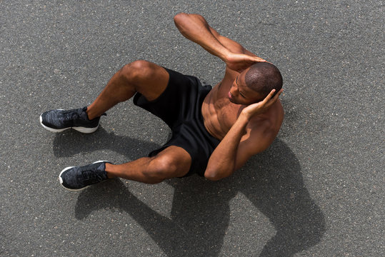 Black man training abdominal muscles