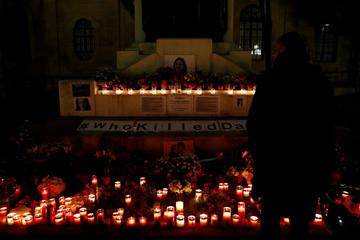 A man looks at a makeshift memorial for assassinated Maltese journalist Daphne Caruana Galizia in Valletta