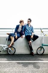 Stylish couple with bicycle