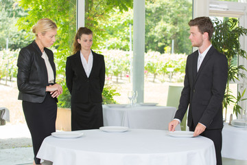 waitress and waiter at catering service in restaurant