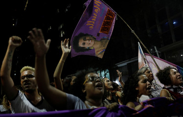 Demonstrators take part in a rally against the shooting of Rio de Janeiro city councilor Marielle Franco in Rio de Janeiro, Brazil
