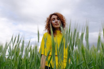 A woman a field of wheat