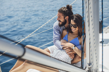 Couple in Love Cuddling on Sailing Boat