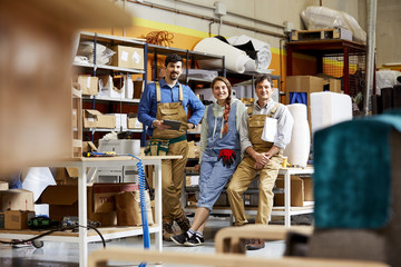 Confident Workers In Sofa Workshop