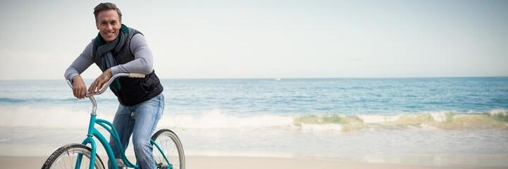 Composite image of digital composite of handsome man on a bike