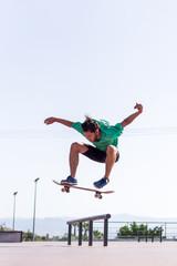 Skateboarder practising his skills in Skate Park