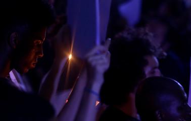 Demonstrators take part in a rally against the shooting of Rio de Janeiro city councilor Marielle Franco in Rio de Janeiro, Brazil