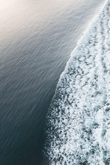 Aerial view of wake from ship vessel in sea