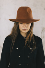 young woman wearing hat