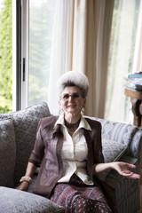 Elegant senior woman's portrait at home
