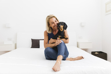 Mature woman holding her dog