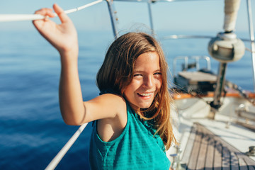 Portrait of a 10 years old girl  on sailboat.