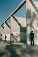 Man and Woman Standing Outside of A Handball Court