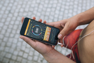 Woman using a running App in smartphone