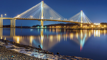 Port Mann Bridge, long exposure in a bright night. Vancouver, British Columbia, Canada.