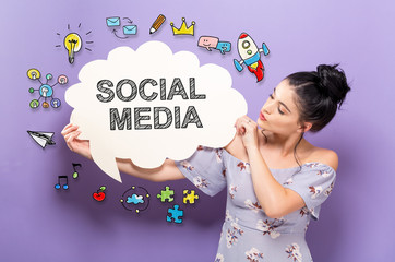 Social Media with young woman holding a speech bubble