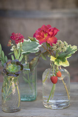 Small flower bouquets in glass jars