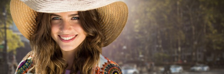 Composite image of beautiful woman with a straw hat