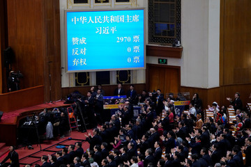 Voting results of Chinese President Xi Jinping voted as the president for another term, is seen on a screen at the fifth plenary session of the National People's Congress (NPC) at the Great Hall of the People in Beijing