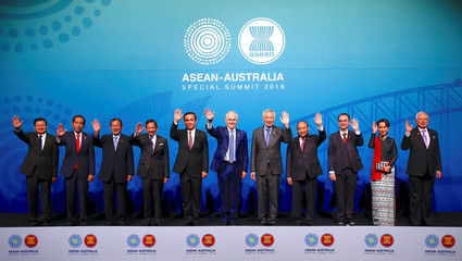 ASEAN leaders wave as they stand together for the Family Photo during the one-off ASEAN summit in Sydney