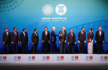 Australia's Prime Minister Malcolm Turnbull gestures to ASEAN leaders to leave the stage after the Family Photo during the one-off ASEAN summit in Sydney