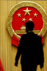 A man enters the assembly hall before the start of the fifth plenary session of the National People's Congress (NPC) at the Great Hall of the People in Beijing
