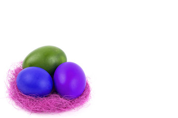 Easter eggs in the nest on a white background