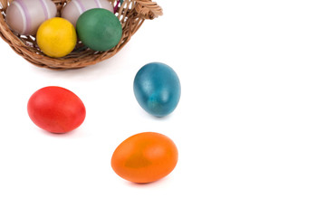 Easter eggs in a basket on a white  background