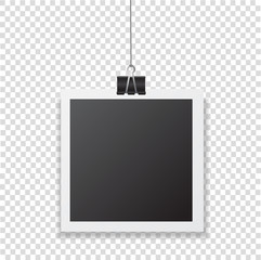 Photo frame with shadow hanging with paper clip. Black square snapshot and metal blinder isolated on transparent background. Vector silver paperclip on picture for your design