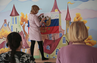 A member of a local electoral commission takes part in preparations for the upcoming presidential election in St. Petersburg