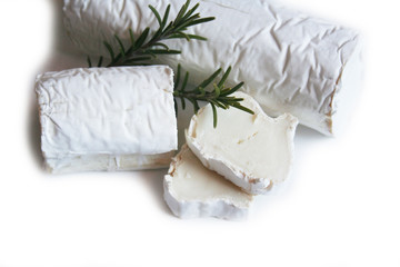 Fresh goat cheese with rosemary isolated on white background