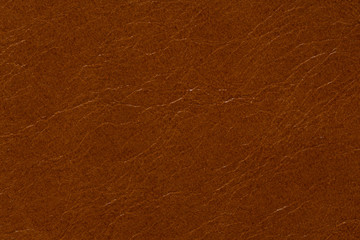 Contrast leather texture in usual brown colour.