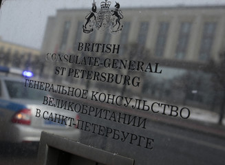 A police car is reflected in a sign outside the building of the British consulate-general in St. Petersburg