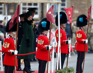 Britain's Catherine, Duchess of Cambridge and Prince William stand on the review dias at the presentation of Shamrock to the 1st Battalion Irish Guards, at a St Patrick's Day parade at Cavalry Barracks in Hounslow, London