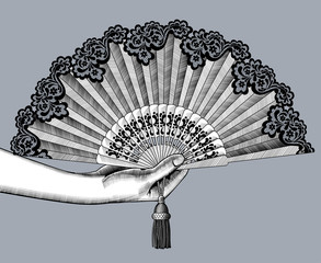 Female hand with open fan