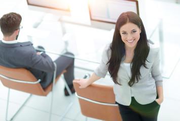 successful business woman standing near modern workplace