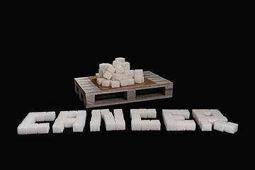 Cancer text written with white refined sugar cubes suggesting dieting concept. No sugar concept suggesting no sugar consumption to improve health
