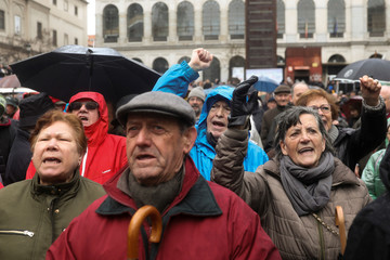 People shout slogans during a demonstration demanding higher state pensions, in Madrid