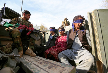 Taliban militants, who were arrested by Afghan security forces, sit on a vehicle, during a presentation to the media, in Jalalabad
