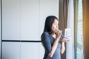 Patient using incentivespirometer or three balls for stimulate lung